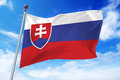 Flag of Slovakia developing against a clear blue sky