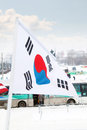 Flag of south korea on wind at winter cloudy day in street city Stock Photos
