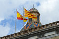 Flag of spain and catalonia barcelona spain at the top palau de la generalitat de catalunya the old city ciutat vella Royalty Free Stock Images
