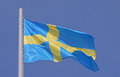 Flag of sweden over blue sky Royalty Free Stock Photos