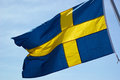 Flag of sweden up in the air with clear sky background Royalty Free Stock Photography