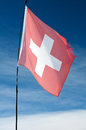 Flag of switzerland against the blue sky Stock Photography