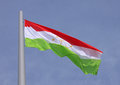 Flag of tajikistan over blue sky Royalty Free Stock Images