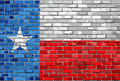 Flag of Texas on a brick wall