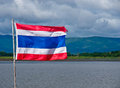 Flag thailand isolated with lagoon and mountains in the background Stock Image