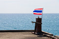 Flag of thailand on small pole in front sea Royalty Free Stock Image