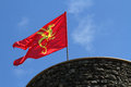 A flag on the tower red with yellow dragon in medieval village of perouges Stock Photography