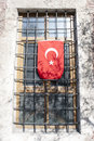 Flag of turkey the hanged on a window with bars istanbul Royalty Free Stock Photography