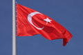 Flag of turkey over blue sky Royalty Free Stock Images