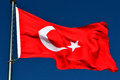 The flag of turkey turkish türk bayrağı meaning turkish is a red including a crescent with a star moving centrally in Stock Photo