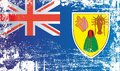 Flag of the Turks and Caicos Islands, British Overseas Territories. Wrinkled dirty spots.