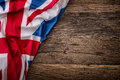 Flag of UK on old wooden background. Union Jack flag on old oak background
