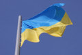 Flag of ukraine over blue sky Stock Photo