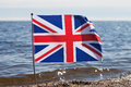Flag of united kingdom at coast Stock Photos