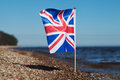 Flag of united kingdom at coast Stock Photo