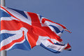 Flag of united kingdom over blue sky Royalty Free Stock Photo