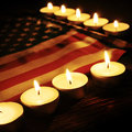 Flag of the United States and lighted candles Royalty Free Stock Photo