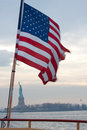 Flag wrapped around the statue of liberty Stock Image