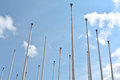 Flagpoles blue sky and in berlin Stock Image