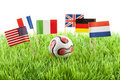 Flags and ball on soccer field Stock Images