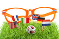 Flags and ball on soccer field Royalty Free Stock Photos