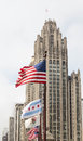 Flags Blowing by Old Chicago Tower Royalty Free Stock Photo