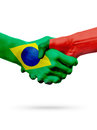 Flags Brazil, Portugal countries, partnership friendship handshake concept. Royalty Free Stock Photo