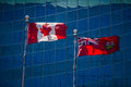 Flags of canada and ontario in front a glass building Royalty Free Stock Photos
