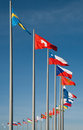 Flags of different countries against the background blue sky Stock Photo