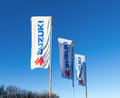 The flags with emblem suzuki samara russia november over blue sky november in samara russia motor corporation is a japanese Stock Images