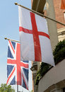 Flags of england and united kingdom the the outside a hotel in london Royalty Free Stock Image
