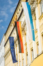 Flags of the european union and germany at a historic facade Stock Image