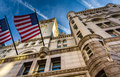 Flags and exterior architecture at the Old Post Office in Washington, DC. Royalty Free Stock Photo