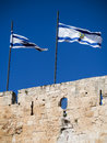 Flags Flying over Wall around Old City of Jerusalem Israel Royalty Free Stock Photo