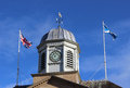 Flags flying on top of kelso town hall scotland close up in the borders regions showing the clock between two flagpoles with the Royalty Free Stock Photography