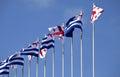 Flags of georgia and adjara autonomous republic in blue sky at sun day Stock Images