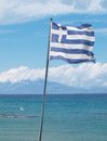 Flags of greece two national over the sea with the island kefalonia Royalty Free Stock Photos