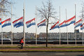 Flags half-mast as commemoration to the deads from WO II. Royalty Free Stock Photo
