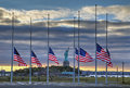Flags at half staff in front of Statue of Liberty Royalty Free Stock Photo