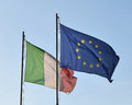 Flags of italy and european union the against the sky Royalty Free Stock Photos
