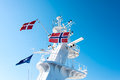 Flags on mast tower norwegian and danish flag a cruise ship flying in the wind over blue sky Royalty Free Stock Photos