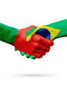 Flags Portugal, Brazil countries, partnership friendship handshake concept. Royalty Free Stock Photo
