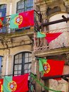 Flags of portugal portuguese on the balconies on the old town porto Royalty Free Stock Photo