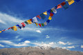 Flags tibetan with mantra on sky background Stock Image
