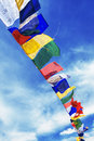 Flags tibetan with mantra on sky background Royalty Free Stock Image