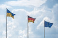 Flags of Ukraine, Germany and the European Union flutter on wind Royalty Free Stock Photo