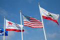Flags in the wind american and californian flowing Royalty Free Stock Photo