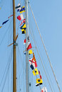 Flags on yachts mast Stock Images
