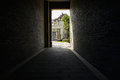 Flagstone paved passageway in building on sunny day the Royalty Free Stock Photography