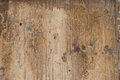 Flaking paint distressed wood with scraped and and weathered surface background or texture muted colours Stock Photo